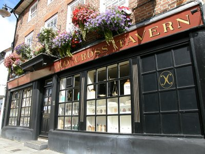 Photo of hanging baskets outside the Old Cross Tavern in St.Andrew Street, Hertford